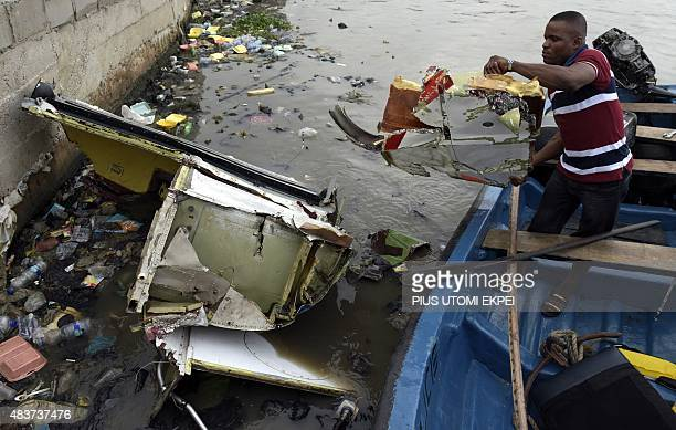 A marine police officer collects parts recovered from the helicopter operated by the USbased Bristow Group which crashed into a lagoon at the...