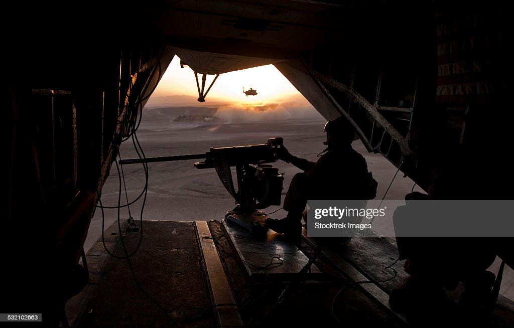 A U.S. Marine provides aerial security from a CH-53E Super Stallion.
