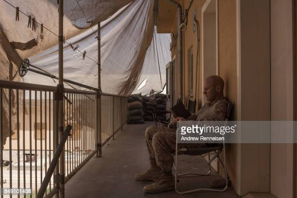 S marine reads a book at Camp Bost on September 11 2017 in Helmand Province Afghanistan About 300 marines are currently deployed in Helmand Province...