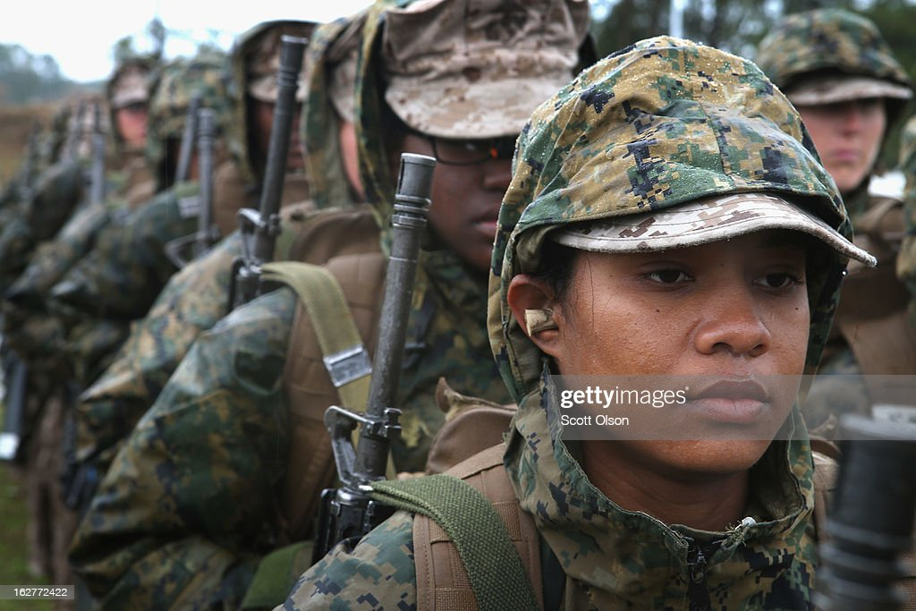 Marine recruit Christina Wauchope waits with other female recruits to fire on the rifle range during boot camp February 25 2013 at MCRD Parris Island...