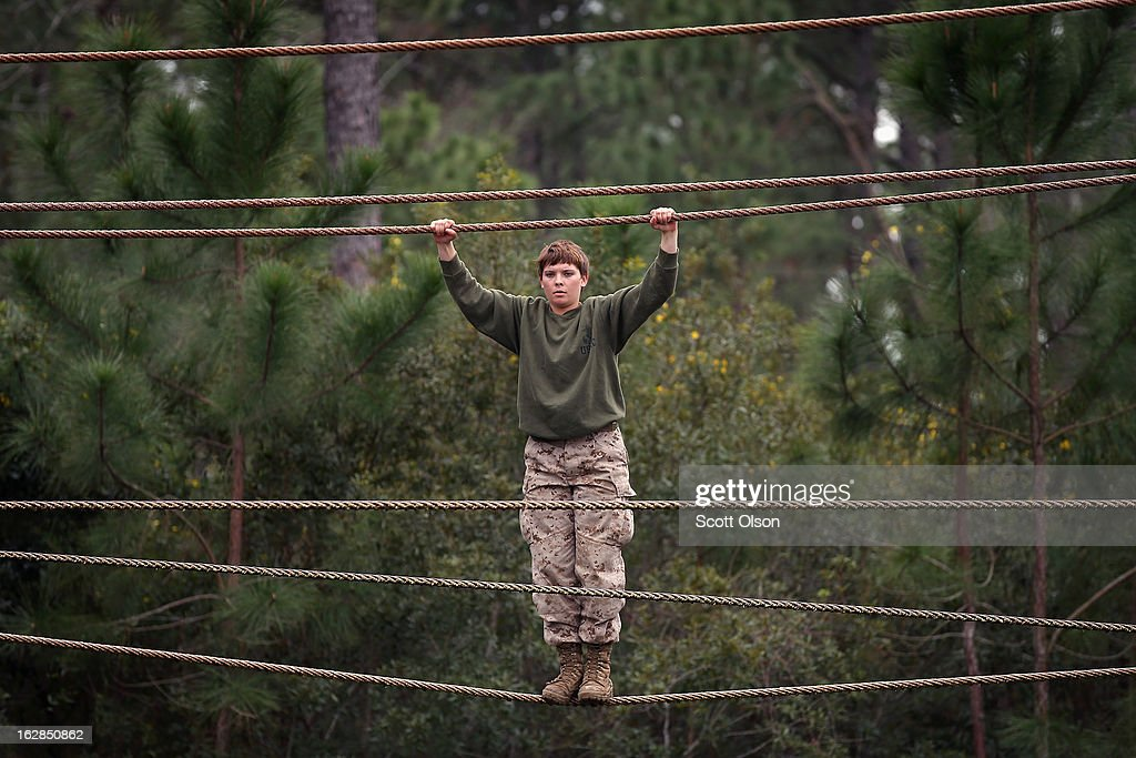 Marine recruit Erin Snider of Elizabeth Kentucky navigates an obstacle on the Confidence Course during boot camp February 27 2013 at MCRD Parris...