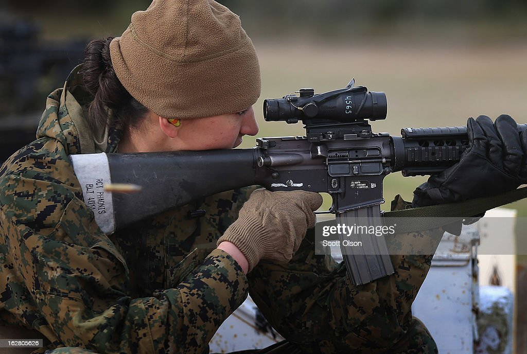Marine recruit India Phandis of Salt Lake City, Utah fires an M16 on the rifle range during boot camp February 27, 2013 at MCRD Parris Island, South Carolina. Female enlisted Marines have gone through recruit training at the base since 1949. About 11 percent of female recruits who arrive at the boot camp fail to complete the training, which can be physically and mentally demanding. On January 24, 2013 Secretary of Defense Leon Panetta rescinded an order, which had been in place since 1994, that restricted women from being attached to ground combat units. About six percent of enlisted Marines are female.