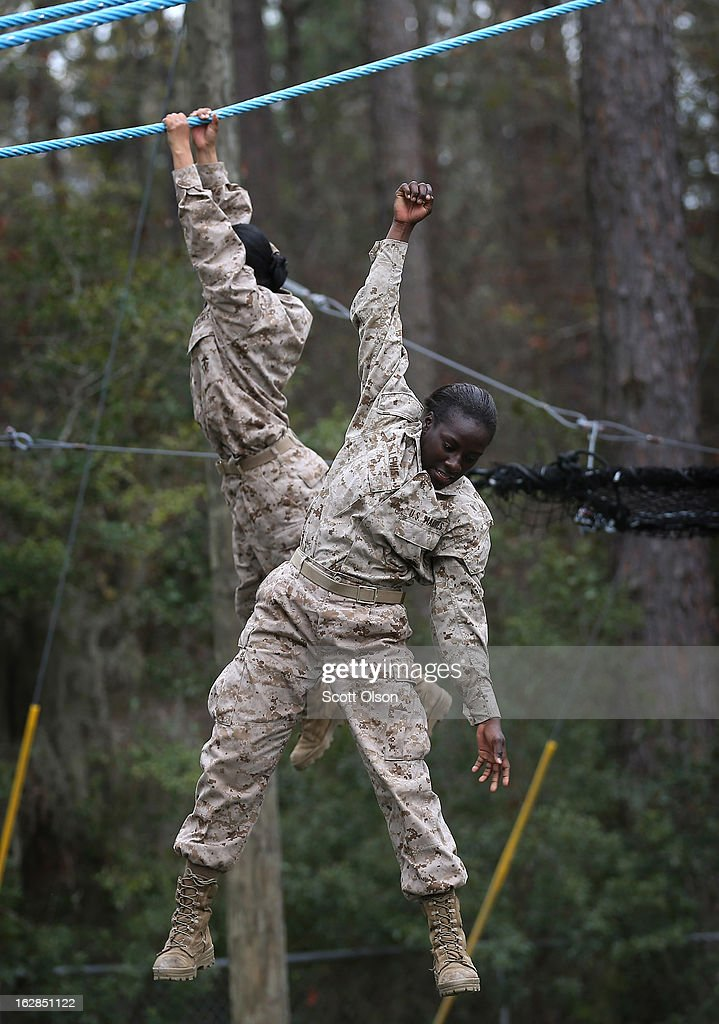 Marine recruit loses her grip and falls while trying to navigate an obstacle on the Confidence Course during boot camp February 27 2013 at MCRD...