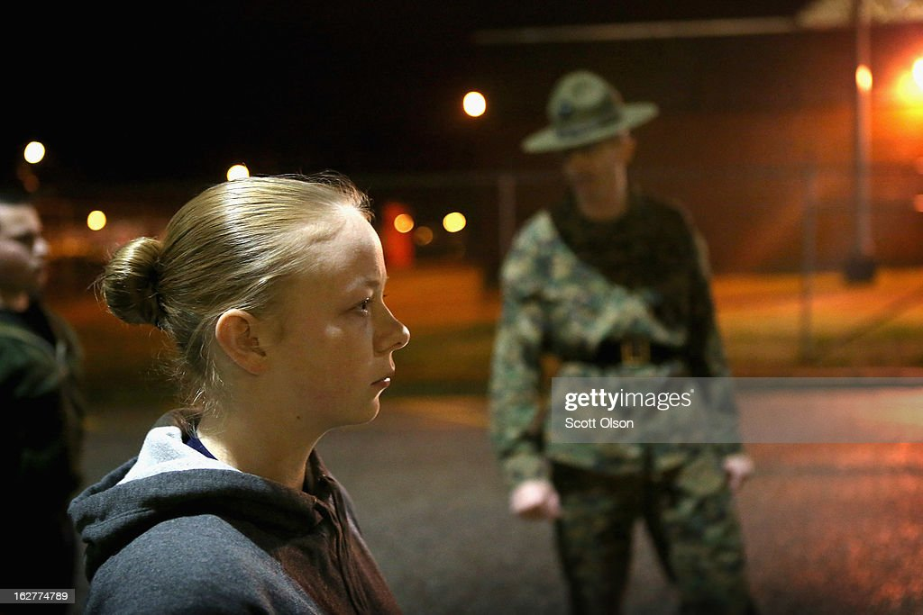 Marine Recruit Tara Ratterree of Catlettsburg, Kentucky listens as Drill Instructor SSgt. Gerald Hemry (R) of Minneapolis, Minnesota barks instructions at her and other Marine recruits after they arrived for boot camp on February 25, 2013 at MCRD Parris Island, South Carolina. Female enlisted Marines have gone through recruit training at the base since 1949. About 11 percent of female recruits who arrive at the boot camp fail to complete the training, which can be physically and mentally demanding. On January 24, 2013 Secretary of Defense Leon Panetta rescinded an order, which had been in place since 1994, that restricted women from being attached to ground combat units.