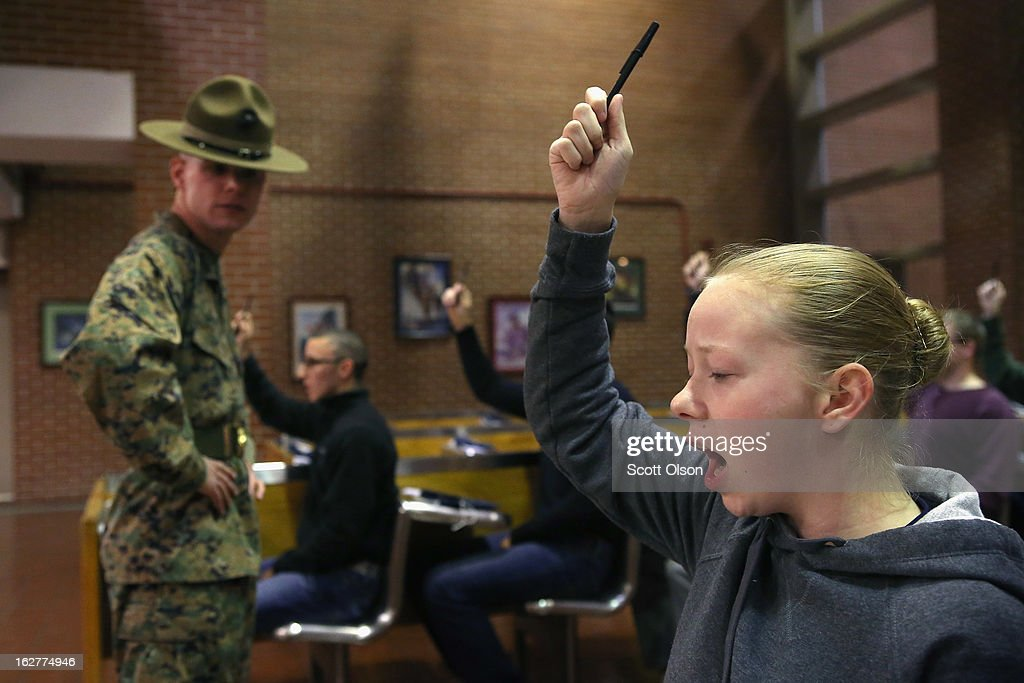 Marine Recruit Tara Ratterree (R) of Catlettsburg, Kentucky listens as Drill Instructor Sgt. Timothy Gentry of Muncie, Indiana shouts instructions at her and other Marine recruits as they are processed into boot camp on February 25, 2013 at MCRD Parris Island, South Carolina. Female enlisted Marines have gone through recruit training at the base since 1949. About 11 percent of female recruits who arrive at the boot camp fail to complete the training, which can be physically and mentally demanding. On January 24, 2013 Secretary of Defense Leon Panetta rescinded an order, which had been in place since 1994, that restricted women from being attached to ground combat units.