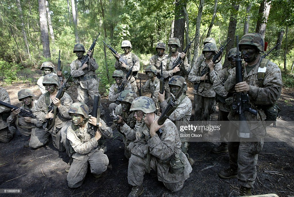 Marine recruits get instructions prior to performing a combat training exercise at the United States Marine Corps Recruit Depot June 21 2004 in...