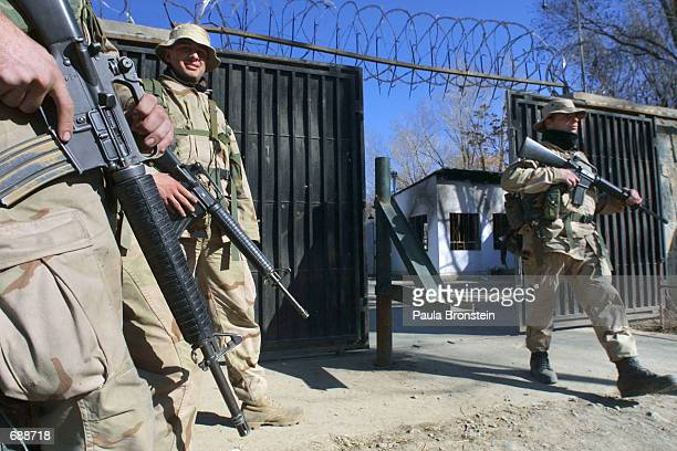 Marine Robert Dewiit from Maryland stands guard at post three inside the US embassy December 21 2001 in Kabul Afghanistan The embassy opened on...