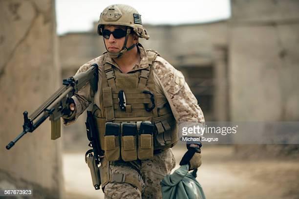 Marine runs in combat