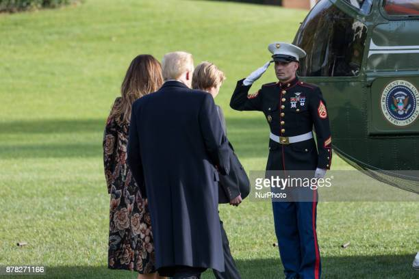 A Marine salutes President Donald Trump as he First Lady Melania Trump and son Barron Trump board Marine One on the South Lawn of the White House in...