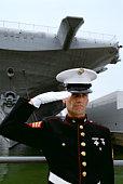 Marine saluting by the Intrepid battleship