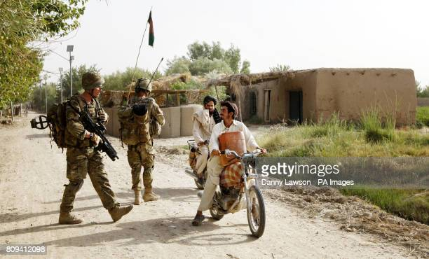 Marine Sam White of XRay Company 45 Commando Royal Marines with locals in the village of Siadabad while on patrol from Patrol Base Kalang in...