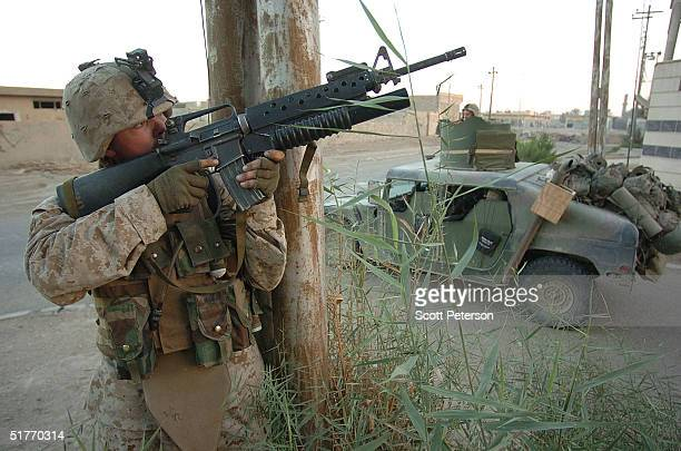 S Marine scouts of the 1st Light Armored Reconnaissance points his gun while clearing houses November 20 2004 in Fallujah Iraq US and Iraqi forces...