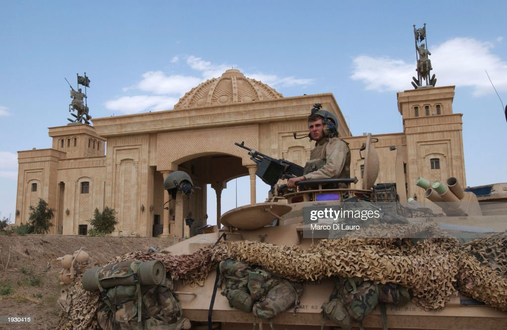 Marine sits on his light armored viechcle in front of Saddam Hussein Palace April 14, 2003 in Tikrit which is located approximately 175 km (108 miles) north of Baghdad. U.S Marines made it to the center of the city and have encountered little resistance.