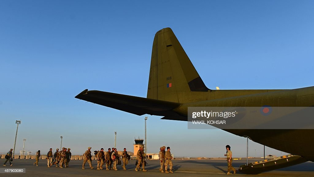 US Marine soldiers enter an airplane as British and US troops withdraw from the Camp BastionLeatherneck complex at Lashkar Gah in Helmand province on...