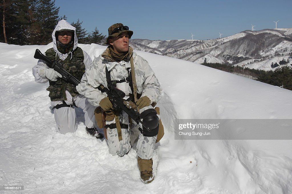 S. marine soldiers from 1st battalion 3rd marine deployed from Hawaii, and South Korean marine soldiers participate in the U.S. and South Korean Marines joint winter exercise on February 7, 2013 in Pyeongchang-gun, South Korea. The South Korean troops train in temperatures below minus 20 degrees celsius to defend the country against any possible attacks from North Korea.