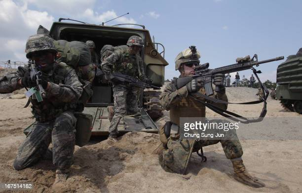 S Marine soldiers from 3rd Marine Expeditionary Force Battalion landing team deployed from Okinawa Japan and South Korean marines participate in the...