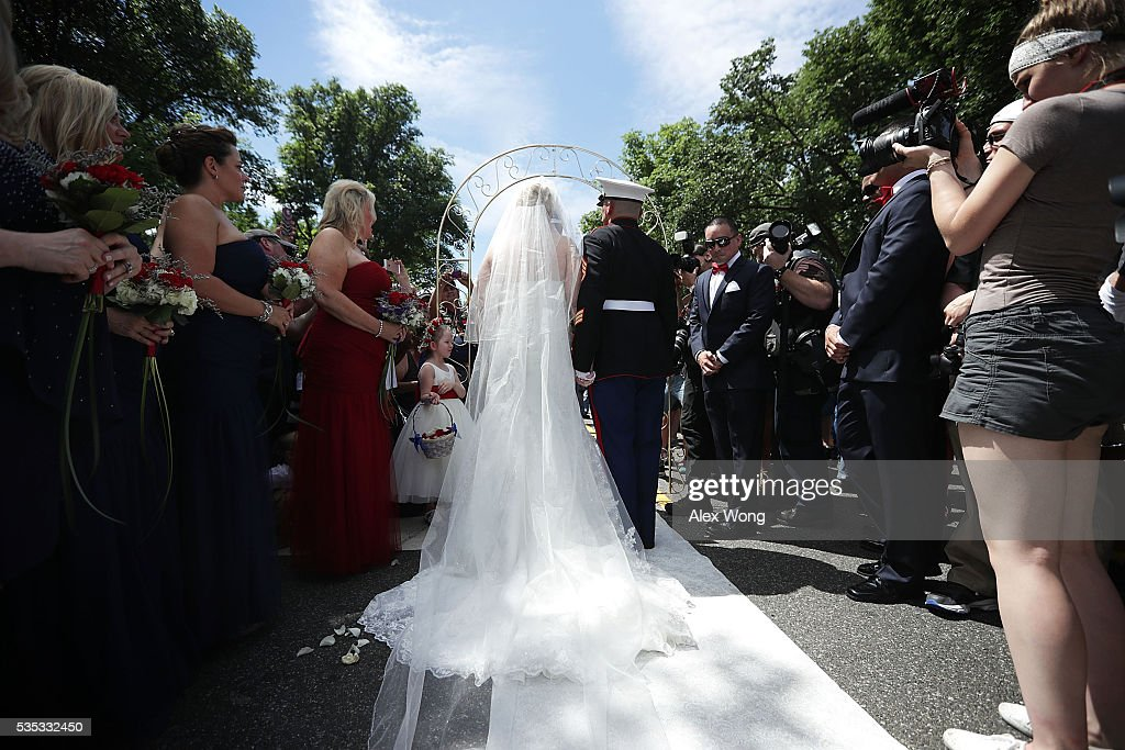 Marine Staff Sgt. Tim Chambers, 'the saluting Marine', gets married to Lorraine Heist prior to the annual Rolling Thunder First Amendment Demonstration Run May 29, 2016 in Washington, DC. Each year Chambers stands on the route at attention to salute the passing bikers. Bikers are gathering in the annual parade in the nation's capital to remember those who were prisoners of war and missing in action on Memorial Day weekend.