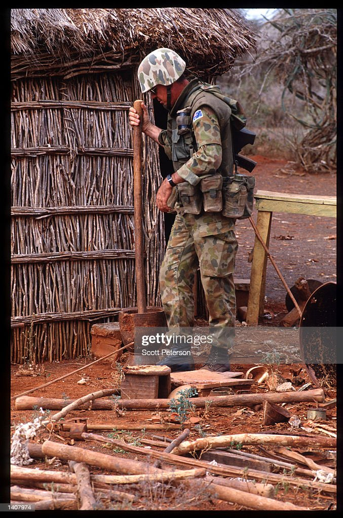 A marine stands near a hut January 15 1993 in Bur Hakaba Somalia US troops arrived in 1992 marking the beginning of a UN peacekeeping mission aimed...