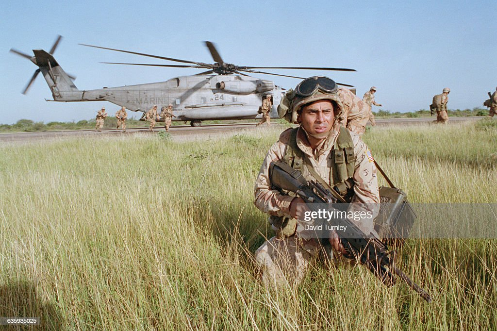 A Marine stays alert as a helicopter lands in Mogadishu during Operation Restore Hope