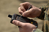 A U.S. Marine Corps civil affairs member of the Humanitarian Assistance Survey Team of Joint Support Forces Japan, uses a hand-held device to check his location using the device's GPS capabilities at