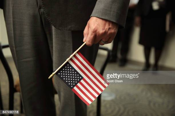 S Marine veteran Hector Alfaro who was three years old when he arrived in the United States is sworn in as US citizens during a ceremony on September...