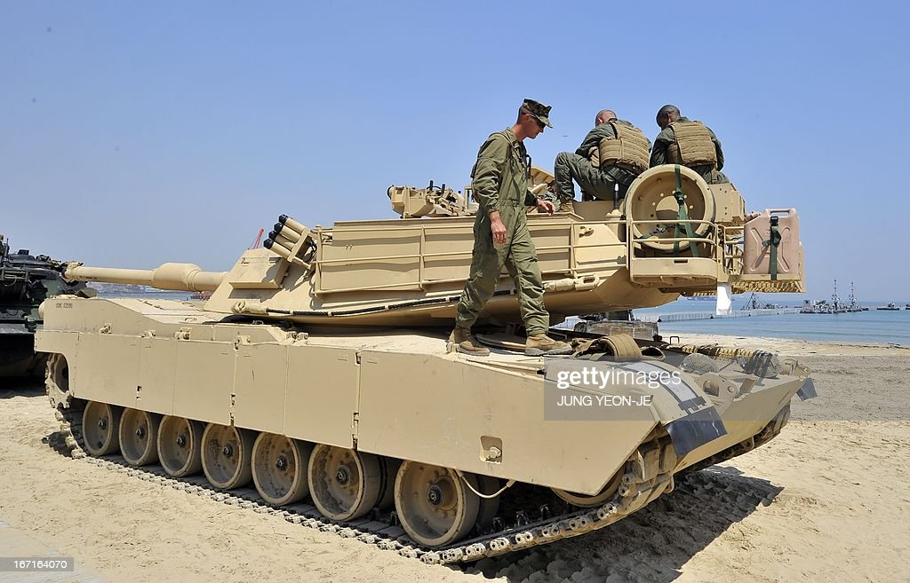 Marine walks across an M1A1 tank at a beach during the Combined Joint Logistics Over the Shore (CJLOTS) exercise in Pohang, 260 kms southeast of Seoul, on April 22, 2013. The wait for North Korea's expected missile test, which has kept South Korean and US forces on heightened alert for the past two weeks, may stretch to July, the South's defence ministry said on April 22.
