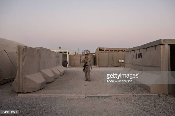 S marine walks inside Camp Shorab on September 11 2017 in Helmand Province Afghanistan About 300 United States Marines are currently deployed in...