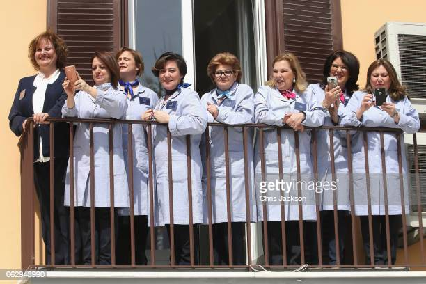 E Marinella fashion house employees await the arrival of Camilla Duchess of Cornwall on the second day of her tour of Italy on April 1 2017 in Naples...