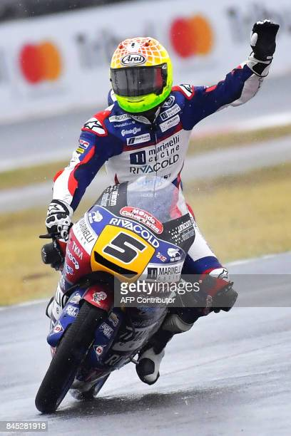 Marinelli racing's rider Romano Fenati from Italy celebrates at the end of the San Marino Moto3 Grand Prix race at the Marco Simoncelli Circuit in...
