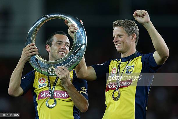 Mariners captain John Hutchinson and Patrick Zwaanswijk of the Mariners celebrate with the trophy after winning the ALeague 2013 Grand Final match...