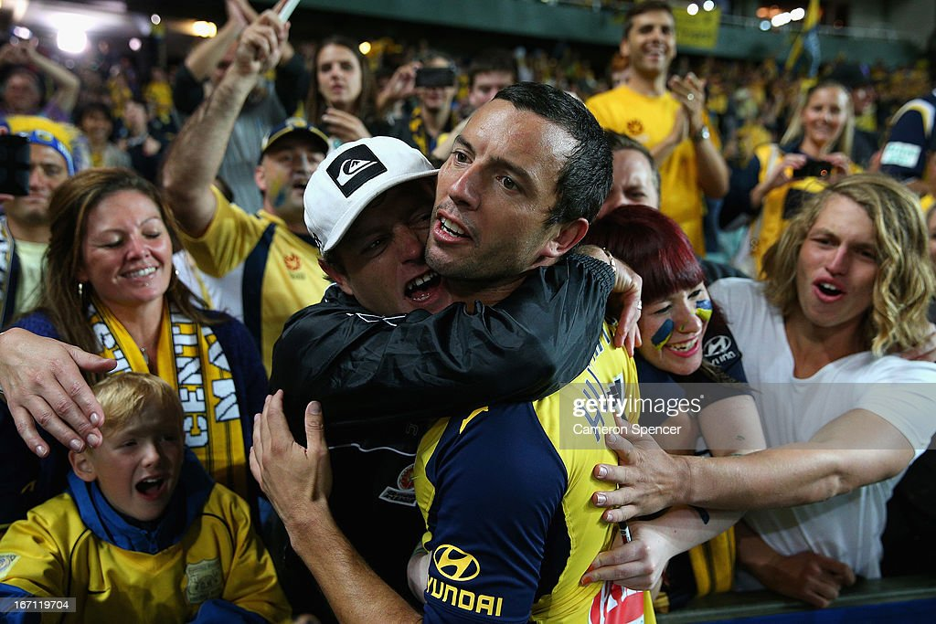 Mariners captain John Hutchinson celebrates with fans after winning the A-League 2013 Grand Final match between the Western Sydney Wanderers and the Central Coast Mariners at Allianz Stadium on April 21, 2013 in Sydney, Australia.