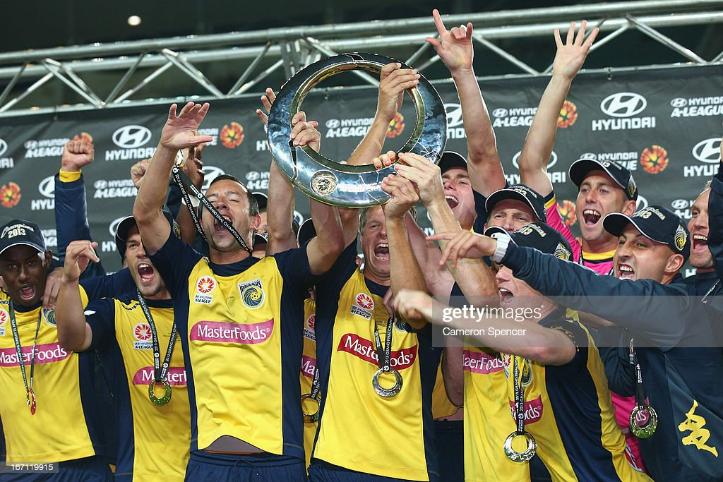 Mariners captain John Hutchinson, Patrick Zwaanswijk of the Mariners and team mates celebrate with the trophy after winning the A-League 2013 Grand Final match between the Western Sydney Wanderers and the Central Coast Mariners at Allianz Stadium on April 21, 2013 in Sydney, Australia.