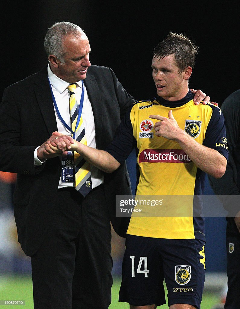 Mariners coach <a gi-track='captionPersonalityLinkClicked' href=/galleries/search?phrase=Graham+Arnold&family=editorial&specificpeople=545662 ng-click='$event.stopPropagation()'>Graham Arnold</a> embraces <a gi-track='captionPersonalityLinkClicked' href=/galleries/search?phrase=Michael+McGlinchey&family=editorial&specificpeople=6123776 ng-click='$event.stopPropagation()'>Michael McGlinchey</a> after he was substituted during the round 20 A-League match between the Central Coast Mariners and the Wellington Phoenix at Bluetongue Stadium on February 7, 2013 in Gosford, Australia.