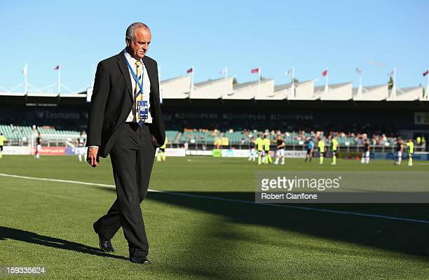 Mariners coach Graham Arnold walks from the ground after he was sent off during the round 16 ALeague match between the Melbourne Victory and the...