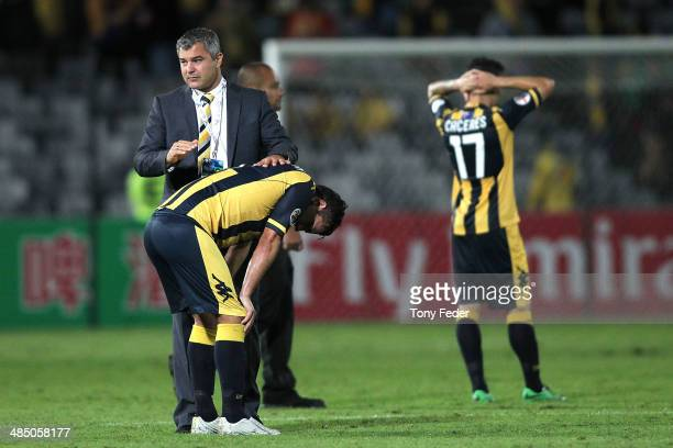 Mariners coach Phil Moss consoles John Hutchinson of the Mariners after the game during the AFC Asian Champions League match between the Central...