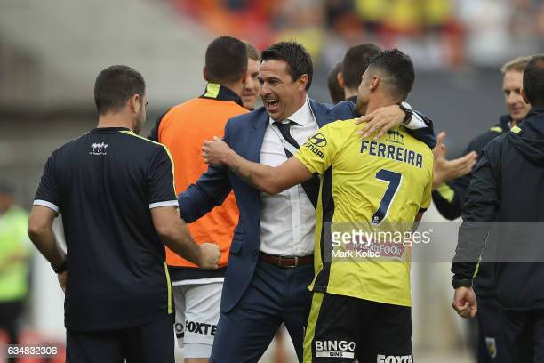 Mariners coach Ron Curry celebrates with Fabio Ferreira of the Mariners after victory during the round 19 ALeague match between the Western Sydney...