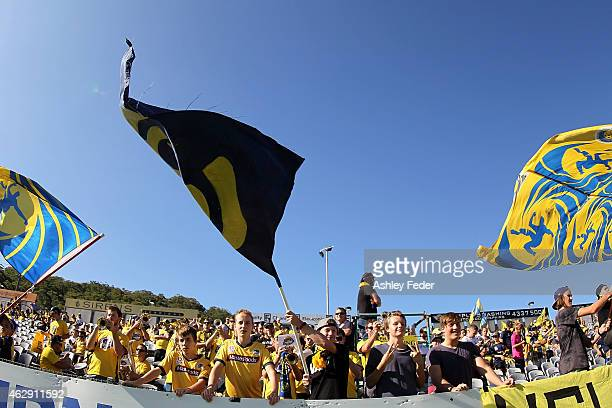 Mariners fans of the 'Yellow Army' show their support during the round 16 ALeague match between the Central Coast Mariners and Adelaide United at...