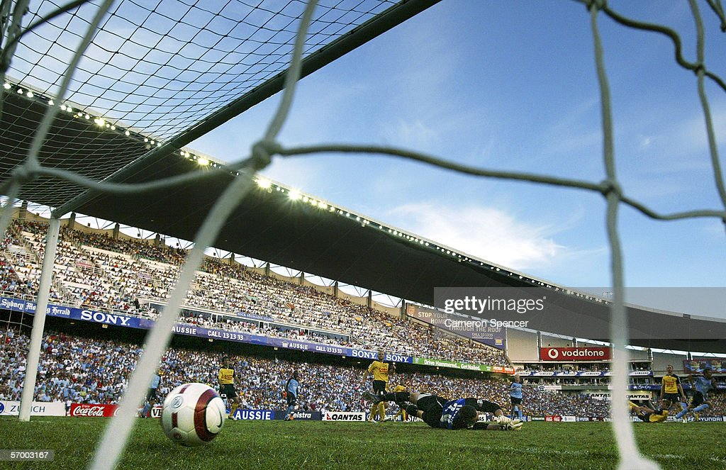 Mariners Goalkeeper Danny Vukovic dives to try and save a goal by Steve Corica of Sydney FC during the Hyundai ALeague Grand Final between Sydney FC...