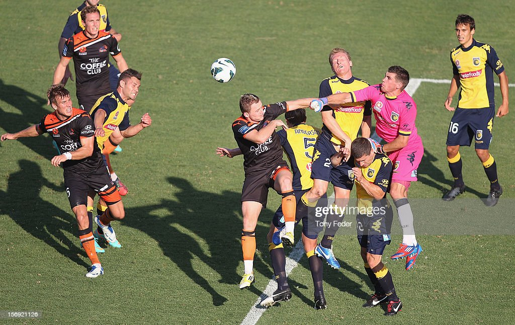 Mariners goalkeeper Mathew Ryan punches the ball clear during the round eight A-League match between the Central Coast Mariners and the Brisbane Roar at at Bluetongue Stadium on November 25, 2012 in Gosford, Australia.
