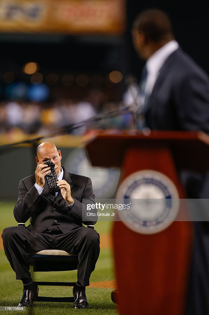 Mariners Hall of Fame member <a gi-track='captionPersonalityLinkClicked' href=/galleries/search?phrase=Jay+Buhner&family=editorial&specificpeople=209293 ng-click='$event.stopPropagation()'>Jay Buhner</a> (L) wipes tears from his eyes with his tie as former Mariners great, <a gi-track='captionPersonalityLinkClicked' href=/galleries/search?phrase=Ken+Griffey+Jr.&family=editorial&specificpeople=171573 ng-click='$event.stopPropagation()'>Ken Griffey Jr.</a> recalls their playing days during a ceremony inducting Griffey into the Seattle Mariners Hall of Fame prior to the game against the Milwaukee Brewers at Safeco Field on August 10, 2013 in Seattle, Washington.