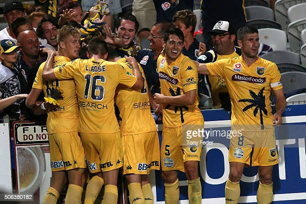 Mariners players celebrate a goal during the round 16 ALeague match between the Central Coast Mariners and the Western Sydney Wanderers at Central...
