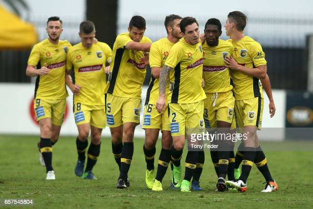 Mariners players celebrate a goal during the round 24 ALeague match between Central Coast Mariners and Adelaide United at Central Coast Stadium on...