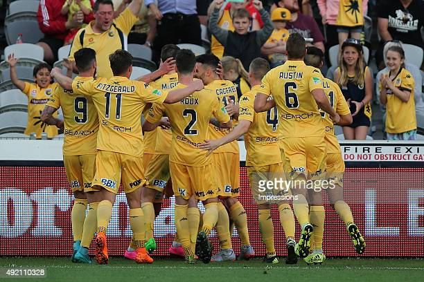 Mariners players celebrate a goal during the round one ALeague match between the Central Coast Mariners and the Perth Glory at Central Coast Stadium...