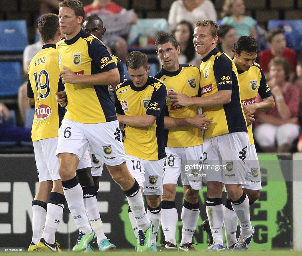 Mariners players celebrate a goal during the round ten A-League match between the Newcastle Jets and the Central Coast Mariners at Hunter Stadium on December 8, 2012 in Newcastle, Australia.