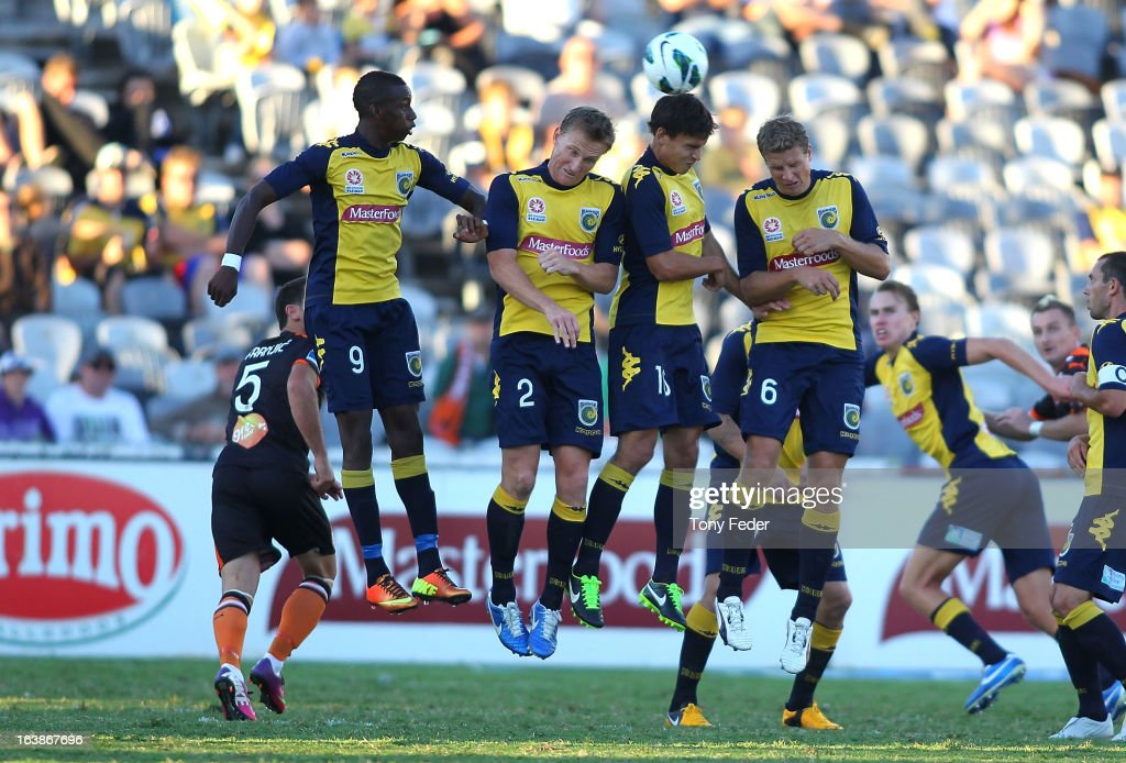 Mariners players jump to try and stop a shot at goal during the round 25 A-League match between the Central Coast Mariners and the Brisbane Roar at Bluetongue Stadium on March 17, 2013 in Gosford, Australia.