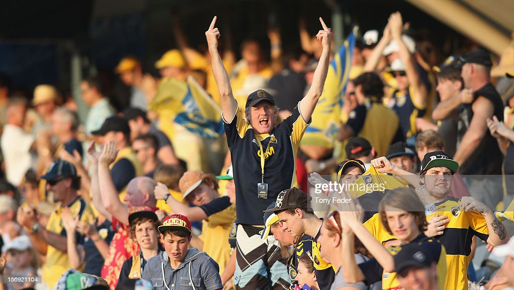 A Mariners supporter celebrates his side winning the game during the round eight A-League match between the Central Coast Mariners and the Brisbane Roar at at Bluetongue Stadium on November 25, 2012 in Gosford, Australia.