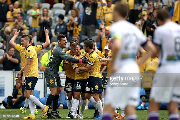 Mariners team mates celebrate a goal by Nick Montgomery with Perth Glory looking dejected in frame during the round 22 ALeague match between the...