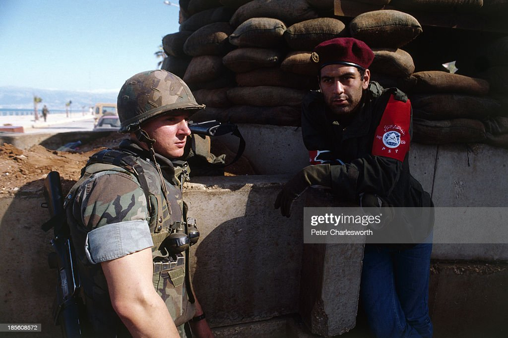 Marines and Druze militia solidiers guard the evactuation of American European and other foreign civilians who are being ferried by US military...