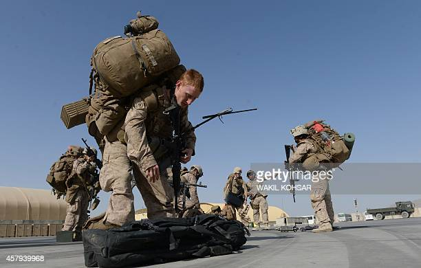 US Marines arrive in Kandahar on October 27 as British and US forces withdraw from the Camp BastionLeatherneck complex in Helmand province British...