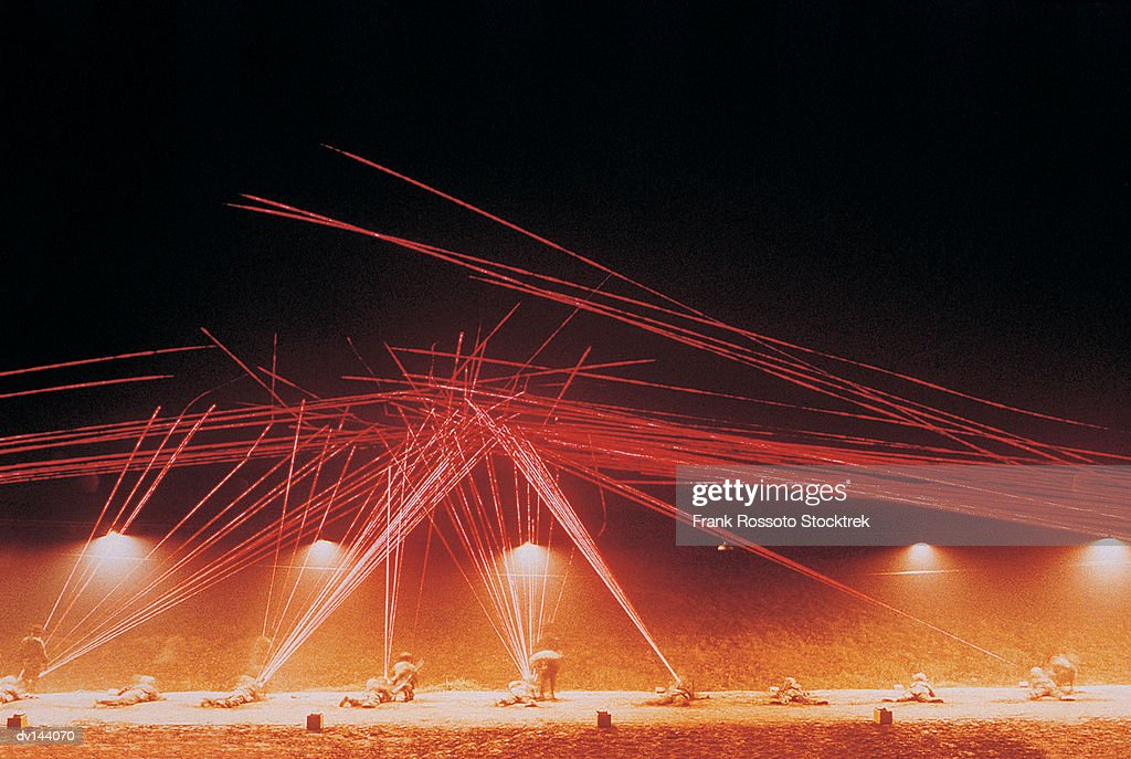 Marines beaming tracer fire lights during night exercise : Stock Photo
